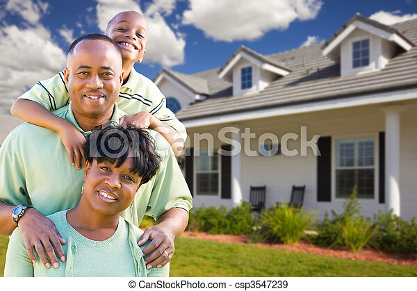Attractive African American Family in Front of Home - csp3547239
