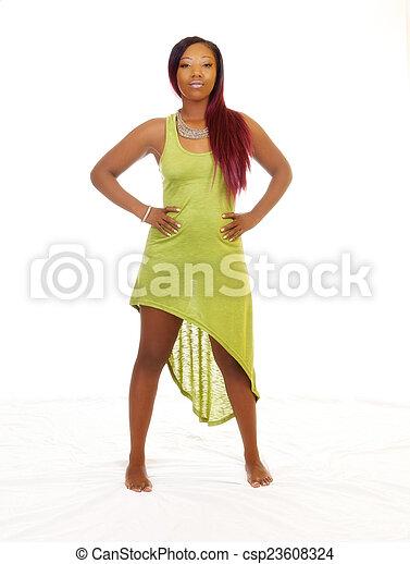 Attractive African American Woman Green Dress Standing - csp23608324