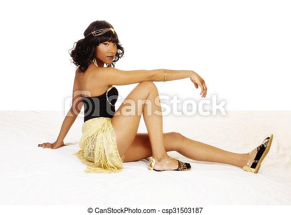 Attractive African American Woman Sitting On Floor - csp31503187