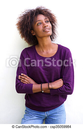 Attractive african american woman against white background - csp35059984