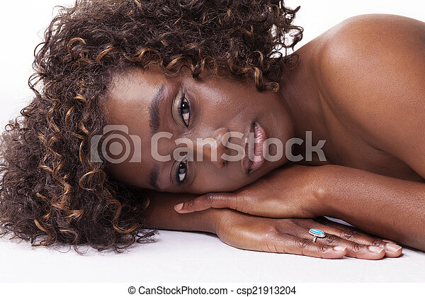 Attractive African American Woman Reclining Portrait - csp21913204