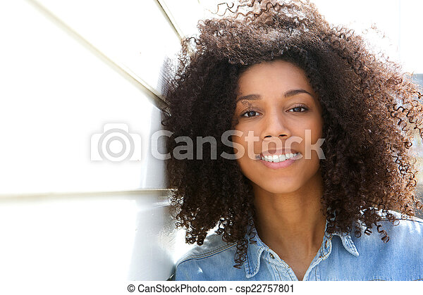 Attractive african american woman smiling - csp22757801