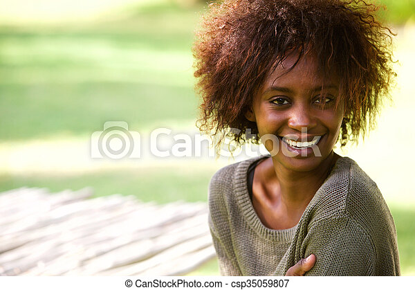 Attractive african american woman smiling - csp35059807