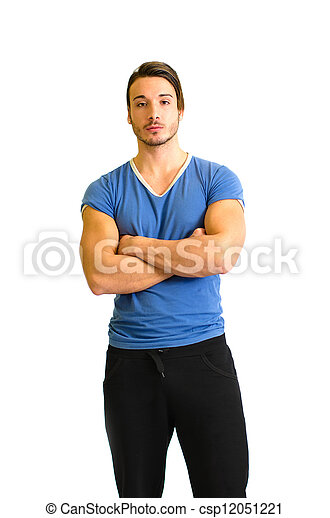 Attractive and fit young man standing, arms crossed - csp12051221
