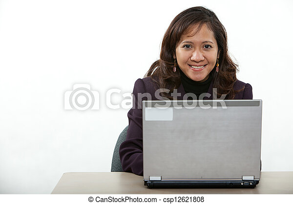 Attractive asian american businesswoman on computer - csp12621808