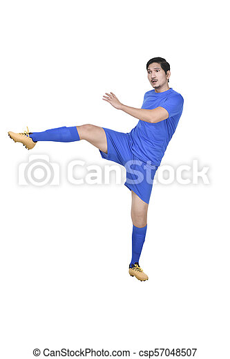 Attractive asian male soccer player kicking the ball - csp57048507