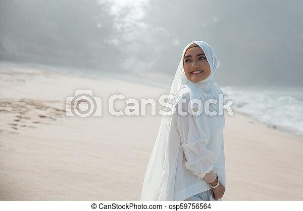 attractive asian muslim woman smiling - csp59756564