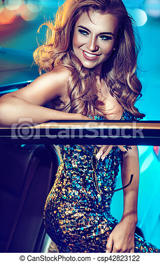 Attractive blond lady with a hollywood smile - csp42823122