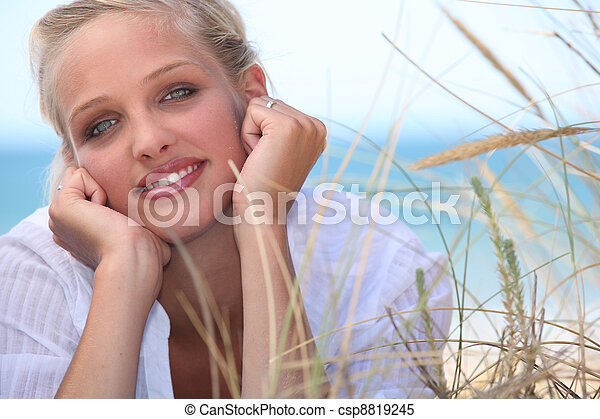 Attractive blond, laid on the beach - csp8819245