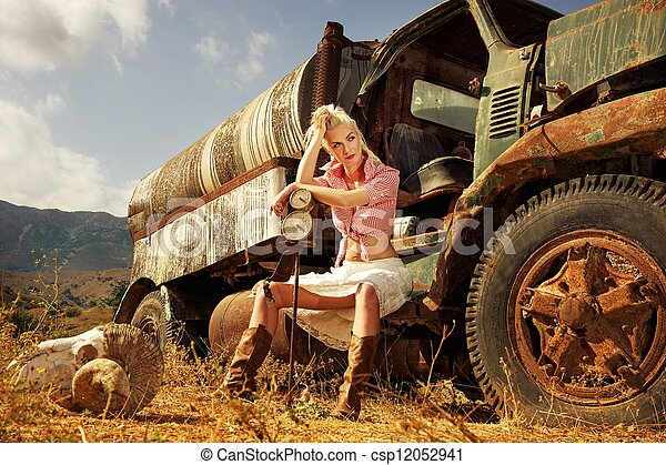 Attractive blond woman sitting in the old car - csp12052941