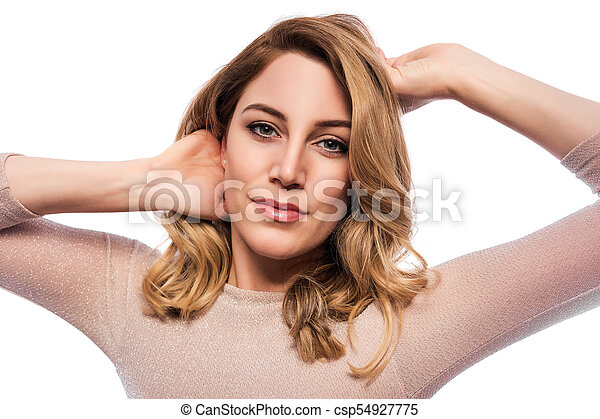 Attractive blond young woman. Portrait of a beautiful woman on a white background. - csp54927775