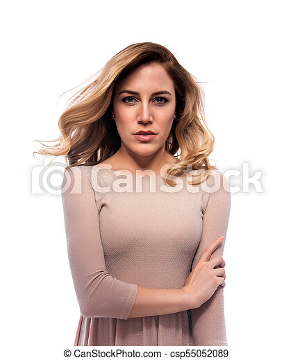 Attractive blond young woman. Portrait of a beautiful woman on a white background. - csp55052089