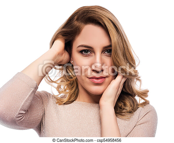Attractive blond young woman. Portrait of a beautiful woman on a white background. - csp54958456
