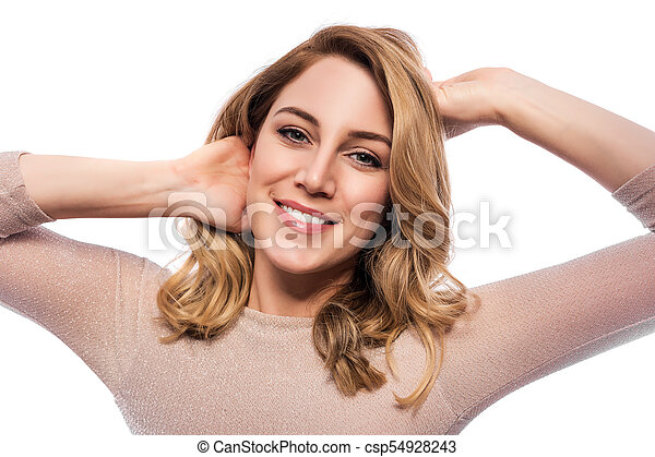 Attractive blond young woman. Portrait of a beautiful woman on a white background. - csp54928243