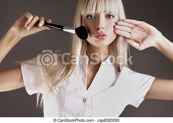 Attractive blonde with face powder brush - csp6320293