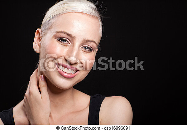 attractive blonde woman portrait on black background - csp16996091