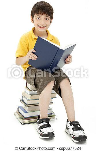 Attractive Boy Child Reading Book - csp6677524