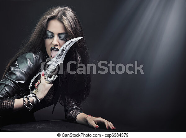 Attractive brunette beauty with knife - csp6384379