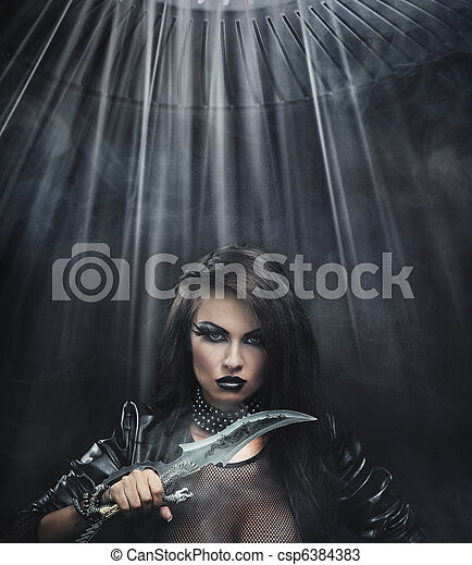 Attractive brunette beauty with knife - csp6384383