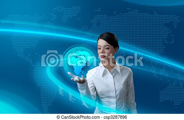 Attractive brunette holding virtual globe - csp3287896
