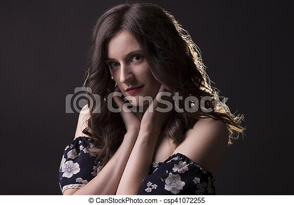 Attractive brunette model in the dark - csp41072255