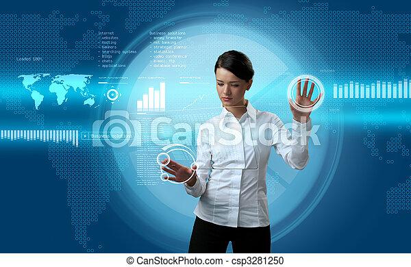 Attractive brunette navigating futuristic interface - csp3281250