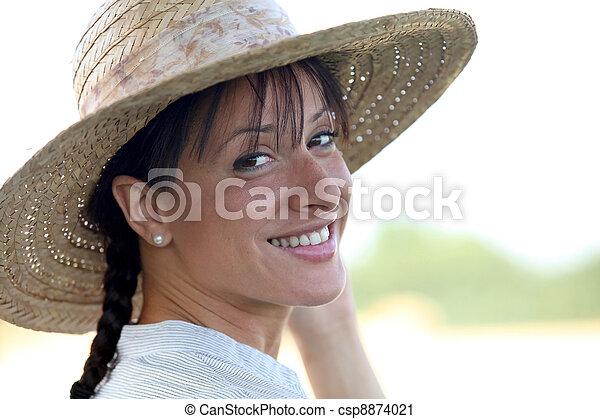 Attractive brunette wearing straw hat - csp8874021