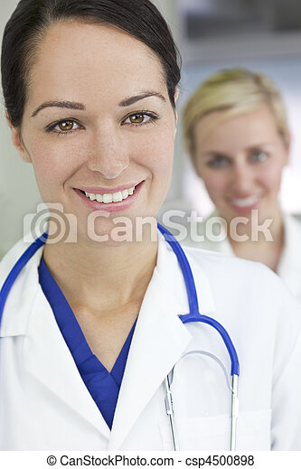 Attractive Brunette Woman Doctor With Stethoscope - csp4500898