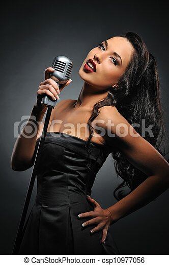 Attractive brunette woman with a retro microphone - csp10977056