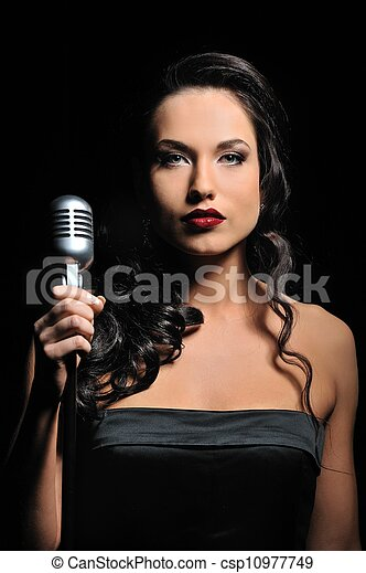 Attractive brunette woman with a retro microphone - csp10977749