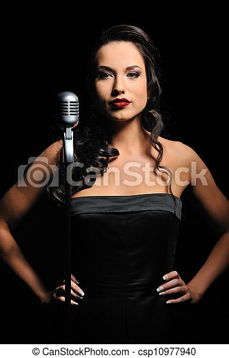 Attractive brunette woman with a retro microphone   - csp10977940