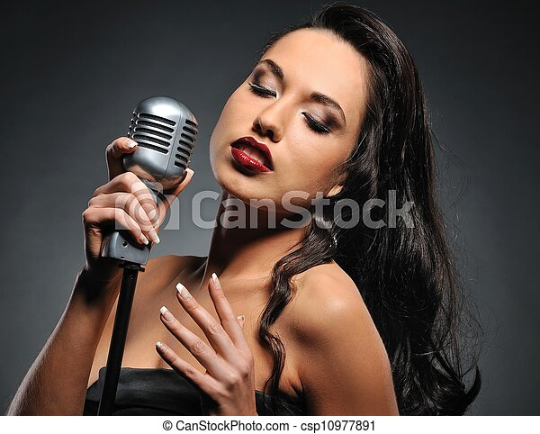 Attractive brunette woman with a retro microphone   - csp10977891