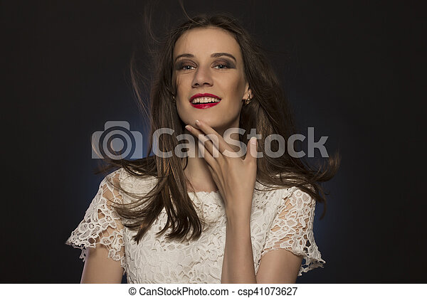 Attractive brunette woman with magnificent hair at studio - csp41073627