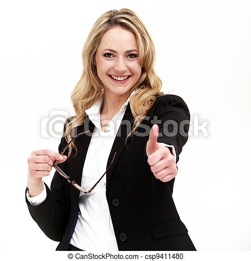 Attractive business woman giving thumbs up - csp9411480
