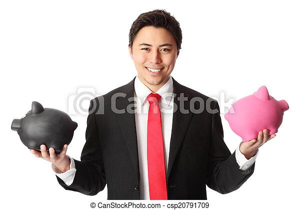 Attractive businessman with piggys - csp20791709