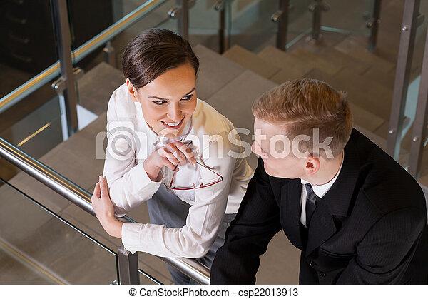 Attractive businesswoman coquetting her co-worker - csp22013913