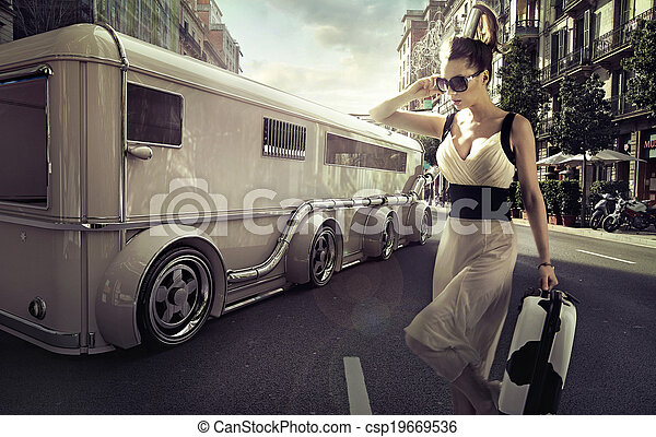 Attractive businesswoman next to the limo - csp19669536