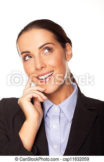 Attractive businesswoman planning her strategy - csp11632059