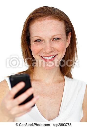 Attractive businesswoman sending a text - csp2893786