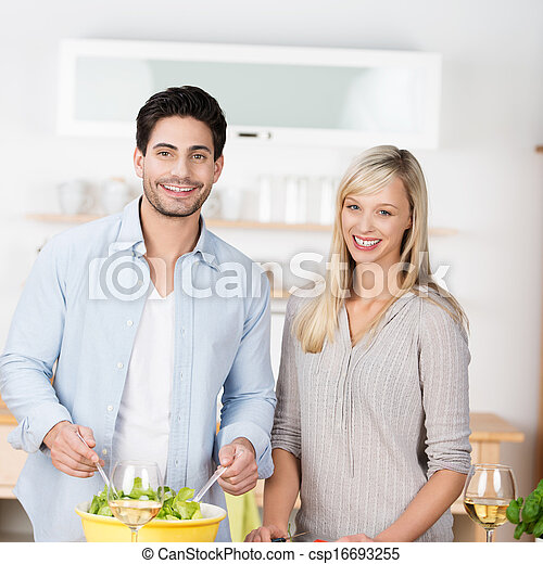 Attractive couple preparing a meal - csp16693255