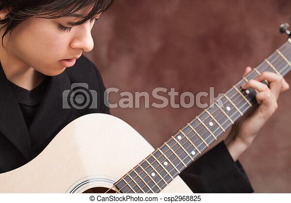attractive ethnic girl plays guitar attractive ethnic girl enjoys