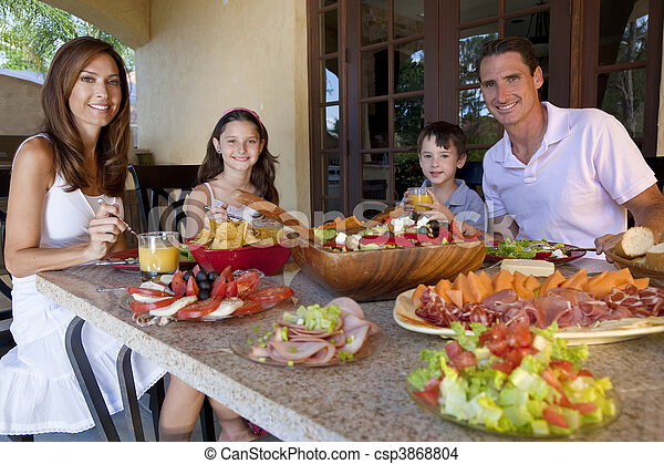 Attractive Family Eating Healthy Salad and Food Meal - csp3868804