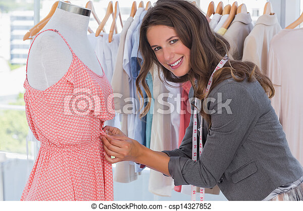 Attractive fashion designer picking needles  - csp14327852
