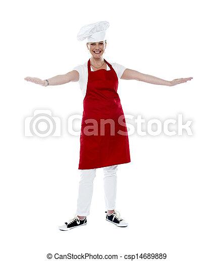 Attractive female chef in red apron and toque - csp14689889
