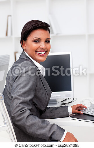 Attractive female executive working at a compute - csp2824095