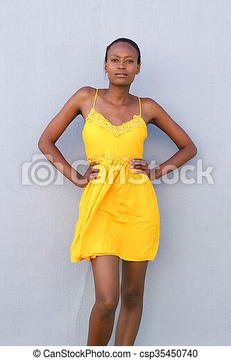 Attractive female fashion model posing in yellow dress - csp35450740
