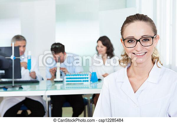 Attractive female lab technician - csp12285484
