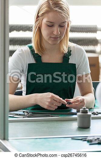 Attractive female line worker - csp26745616