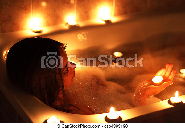 Attractive girl relaxing in her bathtub - csp4393190