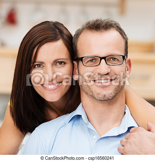 Attractive happy married couple - csp16560241